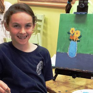 Girl-with-painting-and-easel-square