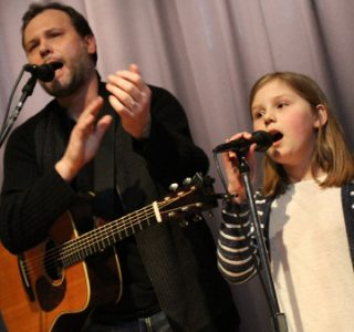 man and young girl singing at MAAV coffeehouse