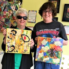 two community members with art